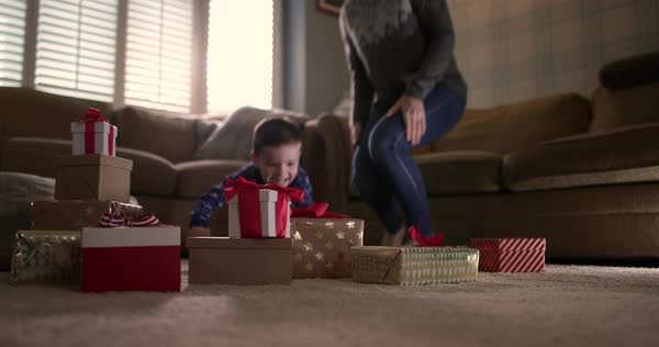 Boy excited on Christmas morning to open presents Royalty-free stock video