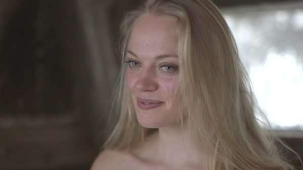 Young woman in sauna, smiling Royalty-free stock video