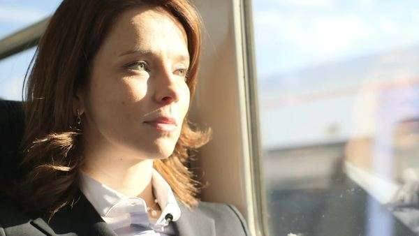 Business Woman types into her ipad/digital tablet on a train, close-up Royalty-free stock video