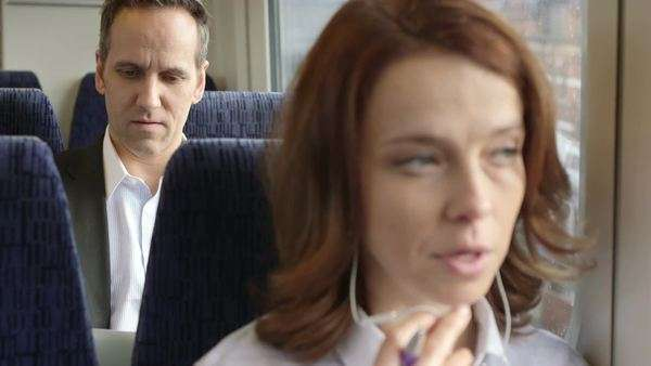 Business Man and Woman commute on the train, close-up Royalty-free stock video