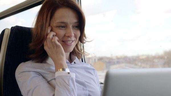 Business woman makes  a call on a train, medium shot Royalty-free stock video