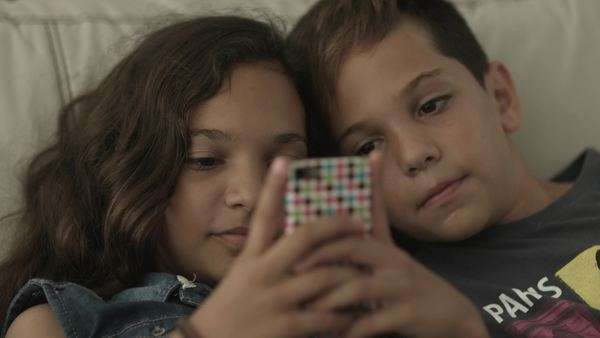 Brother and sister playing with mobile phone, close-up Royalty-free stock video