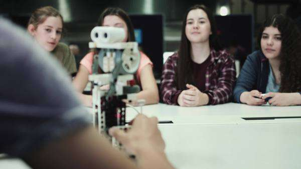 Five children working with small robot at school Royalty-free stock video