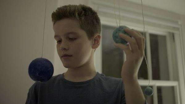 Teenager boy playing with globes in bedroom Royalty-free stock video
