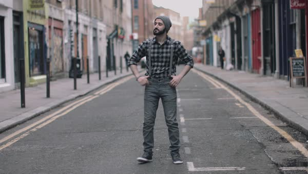 Hipster man dancing in street looking to camera, London, England Royalty-free stock video