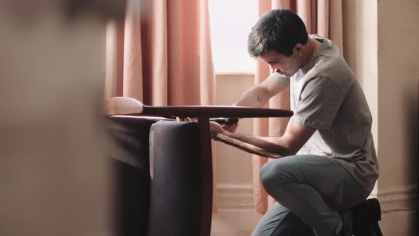 Adult man DIY at home fixing chair Royalty-free stock video