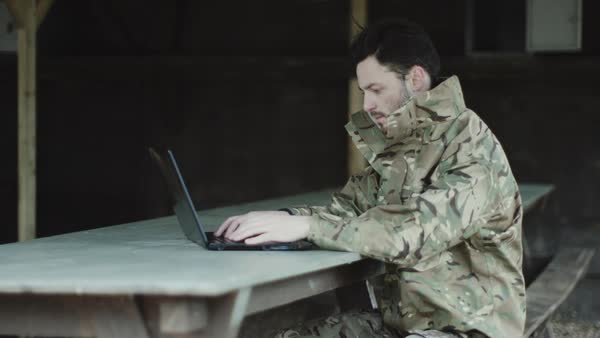 Army soldier on laptop at base camp Royalty-free stock video