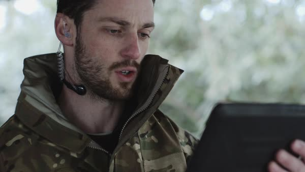 Army Instructor with Digital tablet and headphone giving instructions Royalty-free stock video