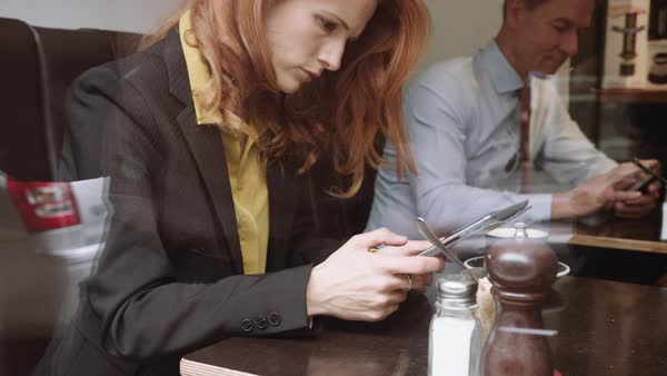 Businesswoman using digital tablet in cafe Royalty-free stock video