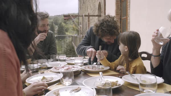 Father helping daughter at family meal Royalty-free stock video