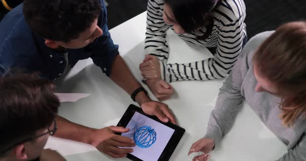 Students with digital tablet looking at design drawing Royalty-free stock video