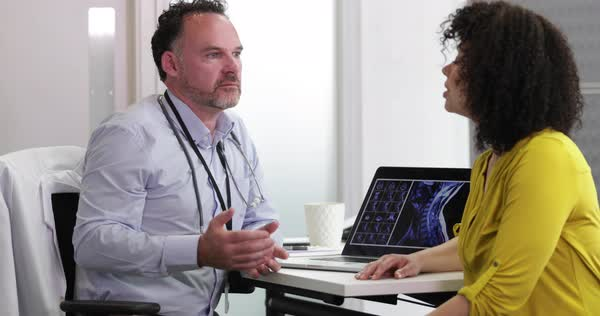 Male medical doctor explaining xray results to patient Royalty-free stock video