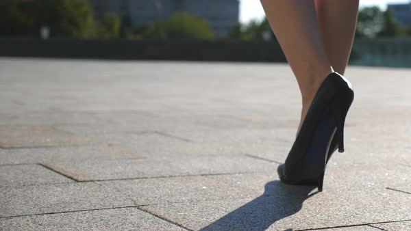 e94be00eb42 Female legs in high heels shoes walking on an urban street. Royalty-free  stock