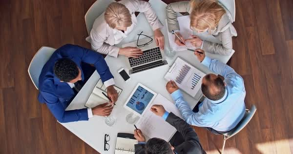 High angle view of business team working with financial report at the table Royalty-free stock video