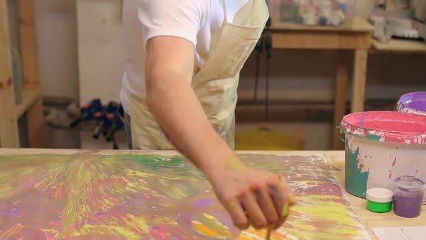 Tilt up of tired artist creating a painting in his studio  Royalty-free stock video