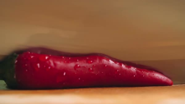 Close-up of cutting red hot pepper on cutting board Royalty-free stock video