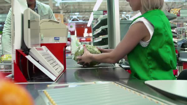 Close up of cash register and products on conveyor belt at grocery store Royalty-free stock video