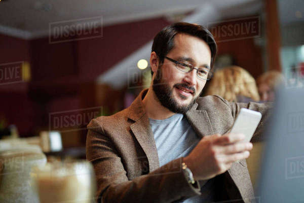 Smiling businessman using mobile phone Royalty-free stock photo