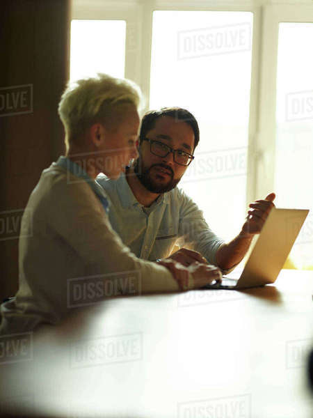 Asian businessman explaining data to co-worker at meeting Royalty-free stock photo