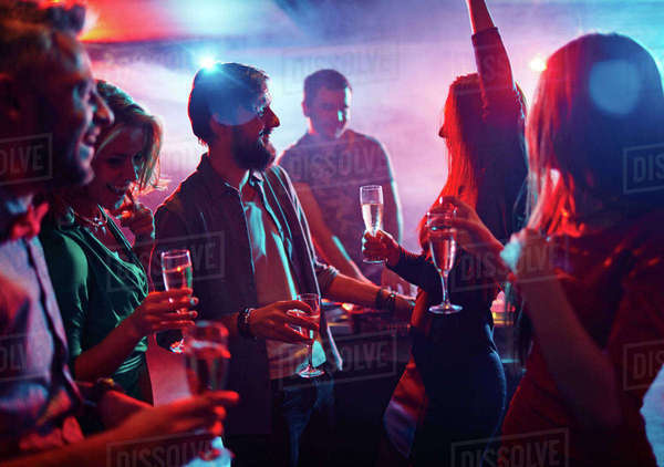 Cheerful friends having good time in night club Royalty-free stock photo