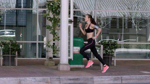 Athletic fitness woman running in urban city Royalty-free stock video