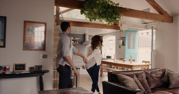Happy couple walk into their dream home and embrace slow motion steadicam shot Royalty-free stock video