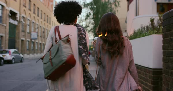 Two beautiful woman friends shopping walking through city urban social consumer lifestyle Royalty-free stock video