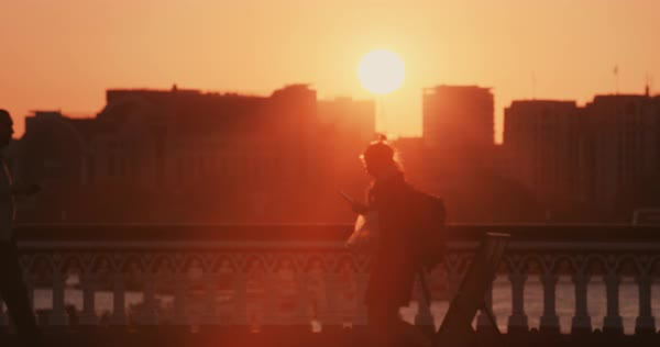 Anonymous crowd of people at sunset walking commuters London City street slow motion Royalty-free stock video