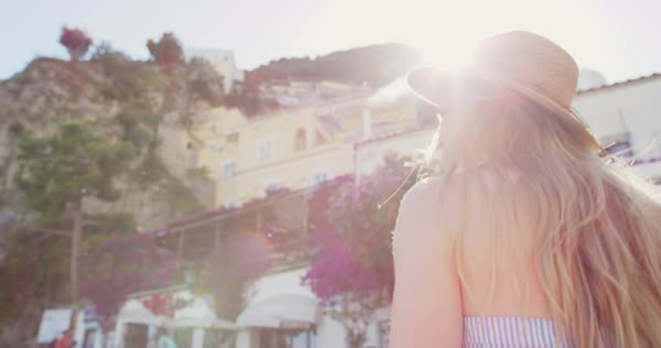 Beautiful woman looking up at view of Positano Amalfi Coast Royalty-free stock video