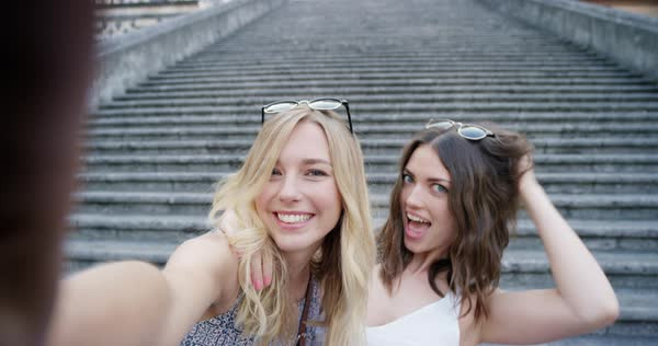 Best friends taking selfie with smartphone travelling together on vacation Royalty-free stock video