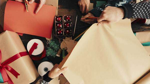 Hands wrapping Christmas presents aerial view Royalty-free stock video
