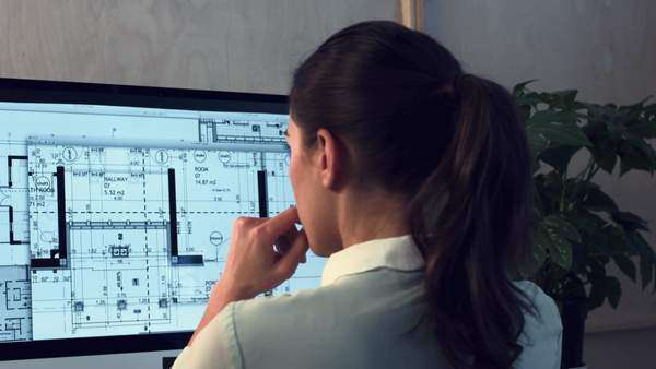 Woman working at home office architectural plans Royalty-free stock video