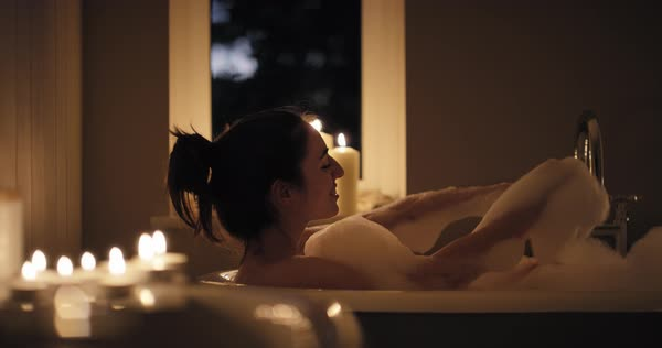 Woman enjoying relaxing bubble bath Royalty-free stock video
