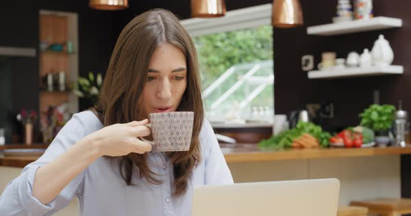 Woman at home drinking coffee using digital tablet trendy loft apartment Royalty-free stock video