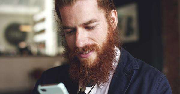 Man using mobile phone in cafe is happy hipster Royalty-free stock video