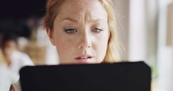 Sad woman using ipad tablet in cafe Royalty-free stock video