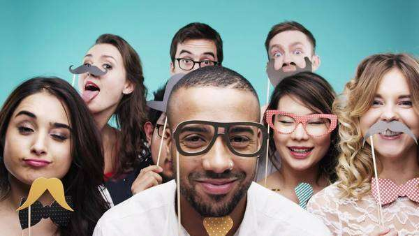 Group of funny people celebrating slow motion party photo booth Royalty-free stock video
