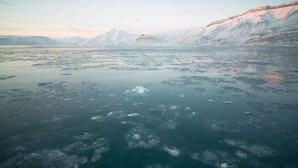 Drifting over the icy Arctic waters of Svalbard, Norway Royalty-free stock video