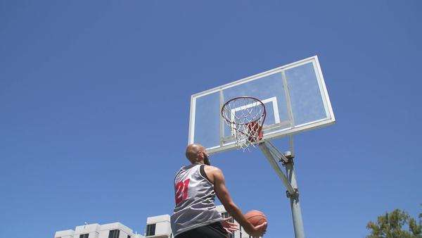 Slow motion basketball player making layup in slow motion Royalty-free stock video