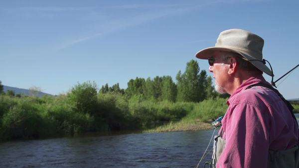 Slow motion active senior man fly fishing outside Royalty-free stock video