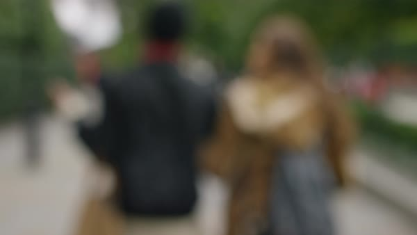 Blurred background shot of two women walking in the city Royalty-free stock video