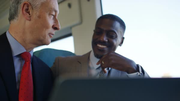 Business team discussing business during a train journey Royalty-free stock video