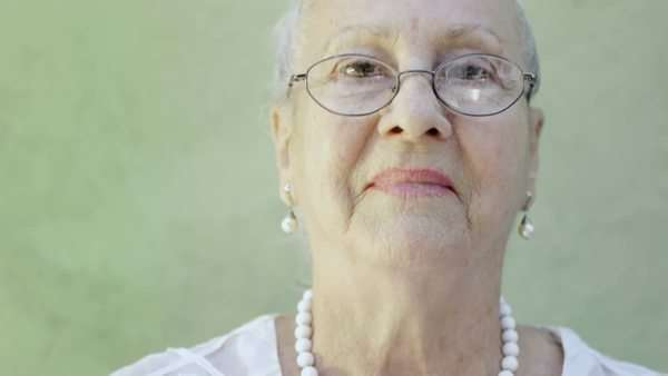 Portrait of old Caucasian woman looking at camera and smiling Royalty-free stock video