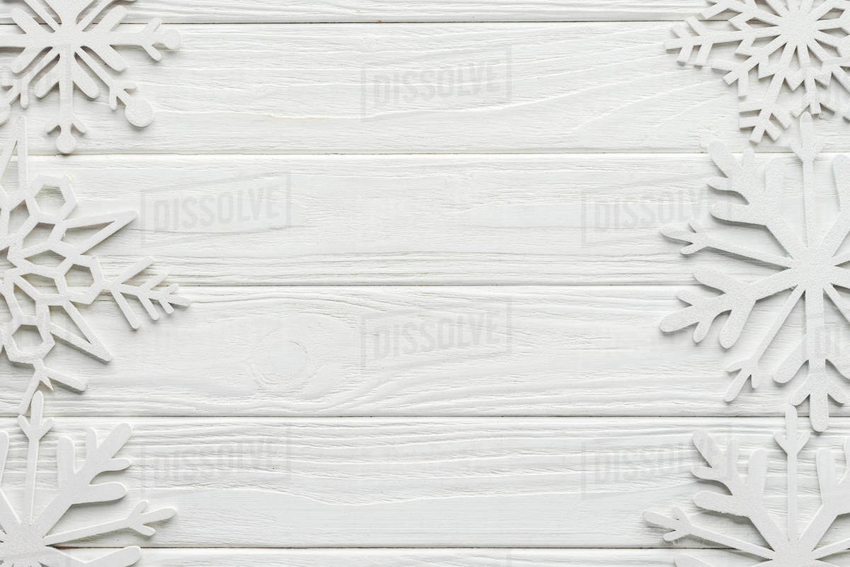 Flat Lay With Decorative Snowflakes On White Wooden Tabletop D2115 154 273