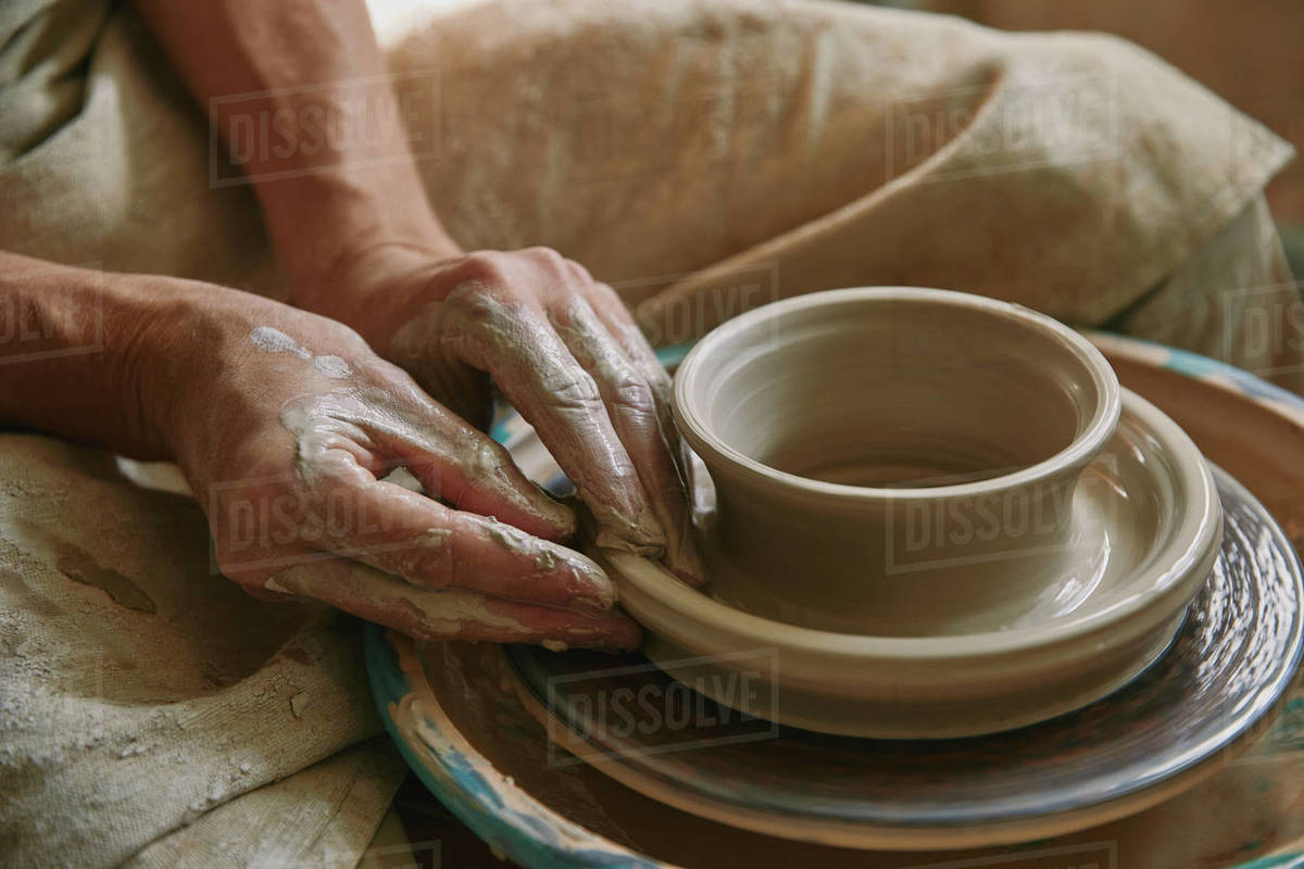 Close Up View Of Professional Potter Working On Pottery Wheel At Workshop Stock Photo Dissolve