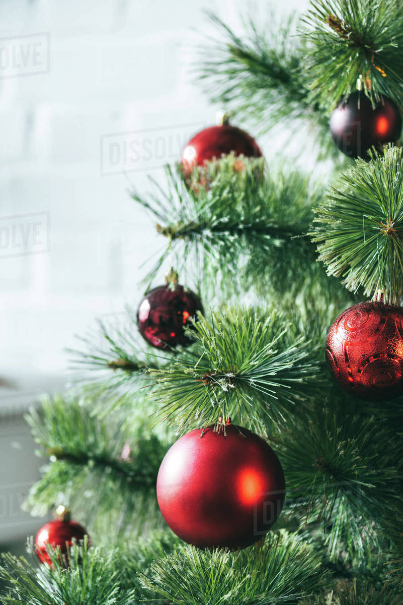 Close Up View Of Red Christmas Balls On Christmas Tree Stock Photo Dissolve
