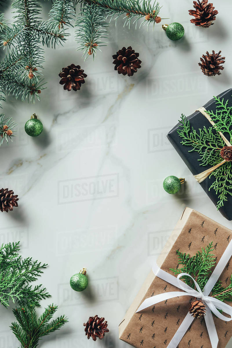 Christmas Top View.Top View Of Christmas Gift Boxes With Fir Branches And Pine Cones On Marble Background With Copy Space Stock Photo