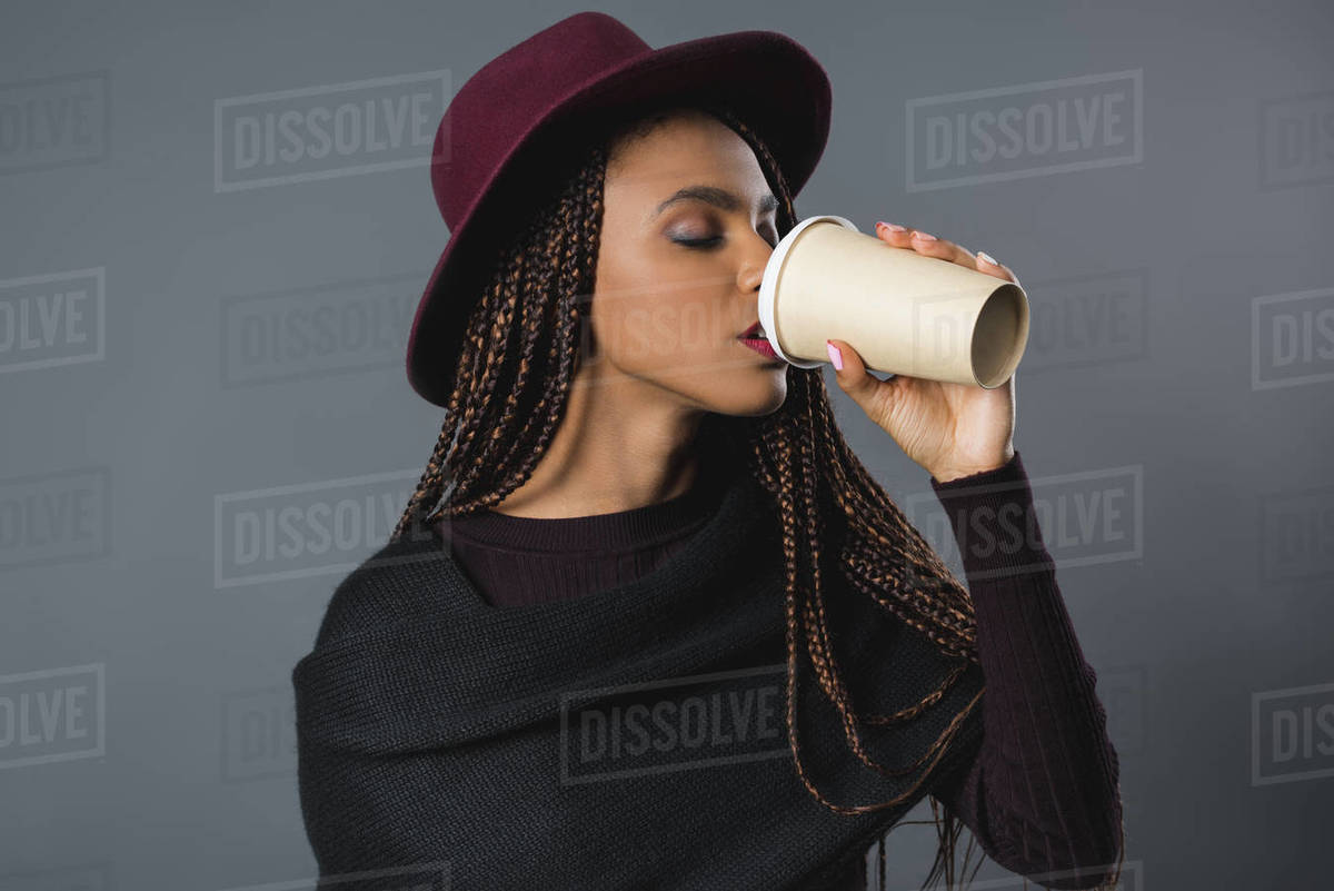Beautiful Young African American Woman Drinking Coffee From Paper Cup Stock Photo Dissolve
