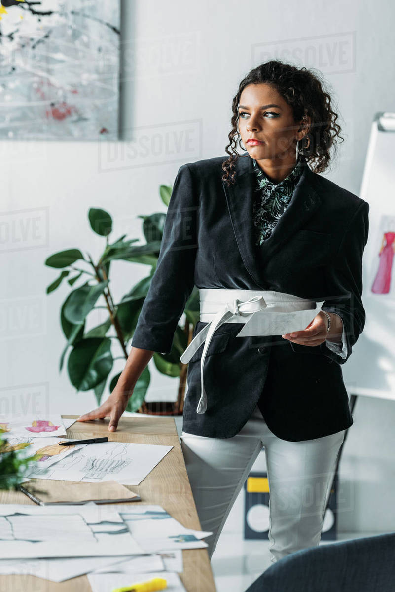 Beautiful Young African American Fashion Designer Looking Away At Workplace Stock Photo Dissolve