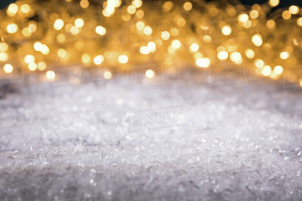 Christmas Winter Background With Snow And Shiny Blurred Lights Stock Photo Dissolve